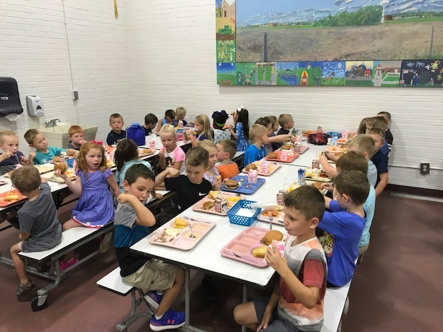 Kindergarteners eating lunch on the first day of school.