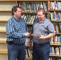 Randy Kleinschmidt receives and appreciation plaque from Board President PJ O'Connor